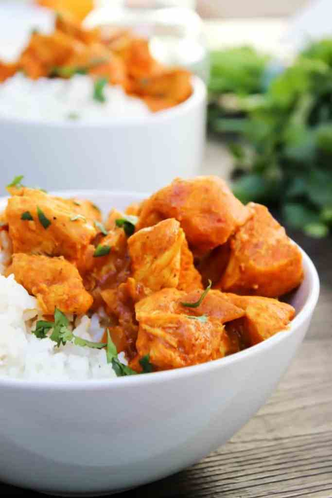 slow cooker, crock pot, chicken recipe, butter chicken, cilantro, rice, white bowl, white plate
