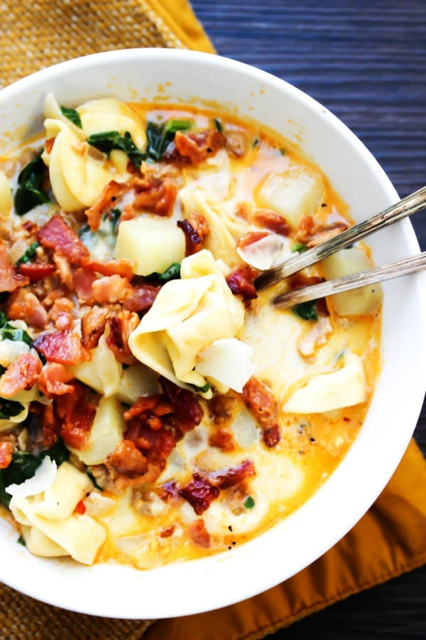 Tortellini Zuppa Toscana white bowl with spoon in it