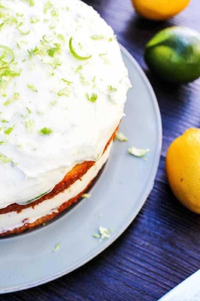 lemon lime layer cake, lemon, lime, cake slice on white plate with forks
