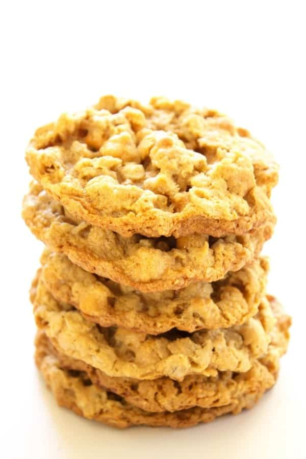 THESE CHEWY OATMEAL PEANUT BUTTER BUTTERSCOTCH COOKIES WILL QUICKLY BECOME A COOKIE JAR FAVORITE. : Stack of cookies on white table