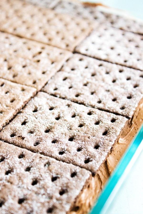 GERMAN CHOCOLATE ICEBOX CAKE - White dish, chocolate graham crackers on frosting