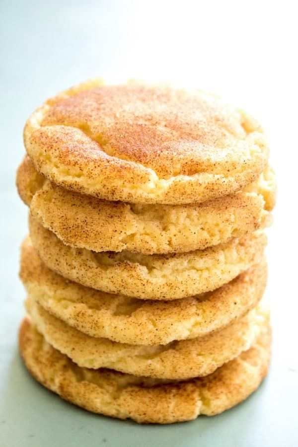 BEST EVER SNICKERDOODLE COOKIE RECIPE - Six cookies stacked up on blue plate