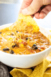 SLOW COOKER CHILI CHEESE DIP – cheesy and full of flavor, this easy recipe will score a win on game day and be a hit during the holidays.