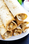 Chicken Parmesan Taquitos - Filled with chicken, cheeses & Italian seasoning, dunk in a marinara sauce & you have a simpler twist on an Italian classic.