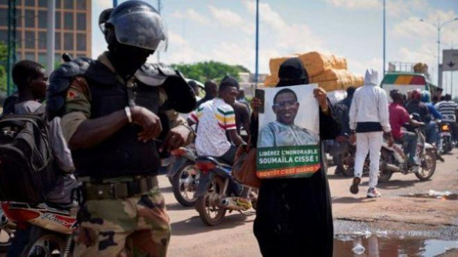 Soumaila Cissé - seen here in a protester's picture - was voted into parliament days after he was kidnapped (Photo: Getty Images)