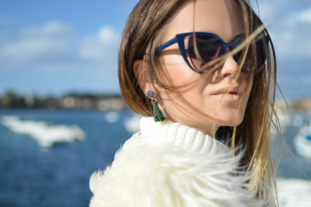 Woman with sunglasses outside
