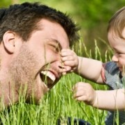 father and child playing