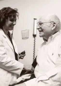 A patient having his blood pressure taken
