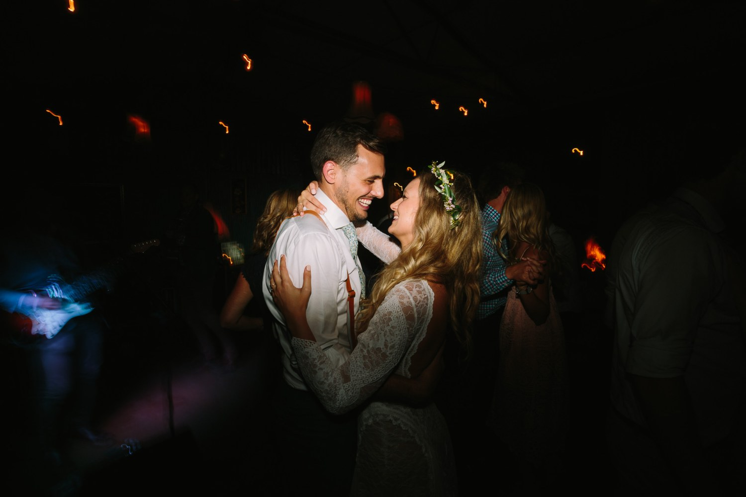 Happy bride and groom on dancefloor at their wedding at Russels pizza in Willunga