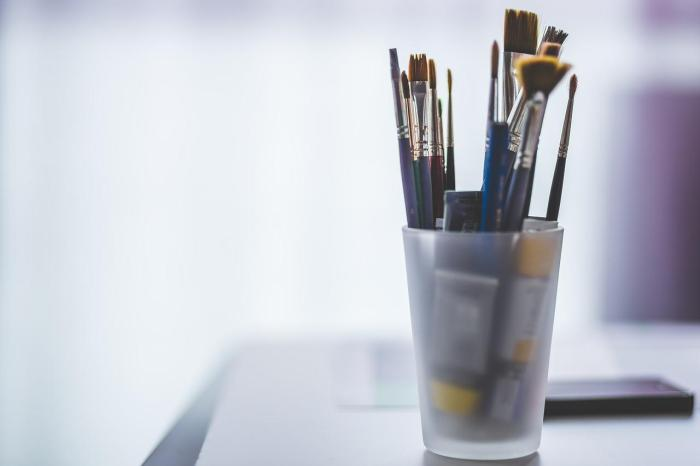 Paint brushes in a glass