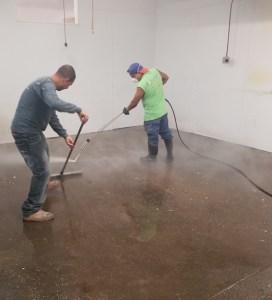 Two men acid etching a diamond floor