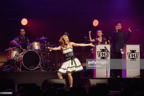 AUCKLAND, NEW ZEALAND - OCTOBER 05: Ariana Savalas of the American band Scott Bradlee's Postmodern Jukebox performs on stage at Auckland Town Hall on October 5, 2018 in Auckland, New Zealand. (Photo by Dave Simpson/WireImage)