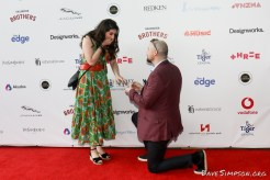 AUCKLAND, NEW ZEALAND - NOVEMBER 15: A guest proposes on the red carpet at the 2018 Vodafone New Zealand Music Awards at Spark Arena on November 15, 2018 in Auckland, New Zealand. (Photo by Dave Simpson/WireImage)