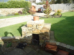 Outdoor fireplace in stone