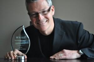 High resolution image of David Cory receiving an award