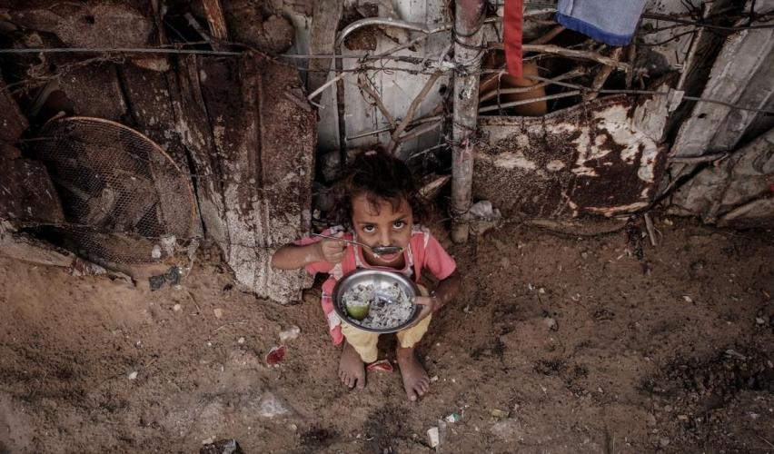 A Palestinian child can be seen outside her home in the poverty-stricken quarter of Al-Zaytoon in Gaza City on 29 September 2014 [Ezz Zanoun/Apaimages]