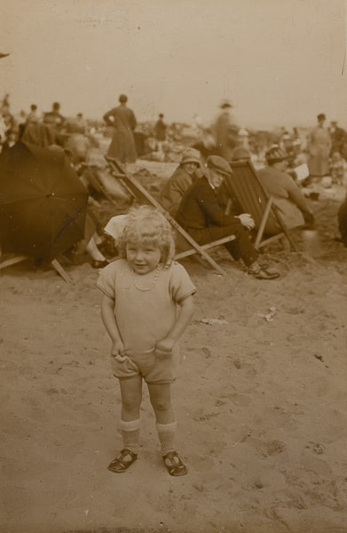 Taken on a beach in an unknown location, in the late 1920's.