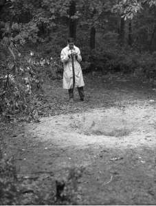 """Danny Shapiro, or his creator, examines """"a vaguely circular hole in a clearing in a New Jersey woods that had been left by an extraterrestrial vehicle in search of soil samples"""" (""""Outtakes of a UFO Investigator,"""" p. 36)."""