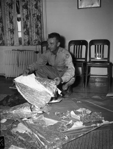Major Jesse Marcel with the alleged Roswell debris. Courtesy, Fort Worth Star-Telegram Photograph Collection, Special Collections, The University of Texas at Arlington Library, Arlington, Texas.