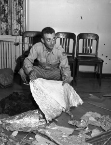 Is this the face of a man forced to be part of a deception? Major Jesse Marcel with the alleged Roswell debris. Courtesy, Fort Worth Star-Telegram Photograph Collection, Special Collections, The University of Texas at Arlington Library, Arlington, Texas.