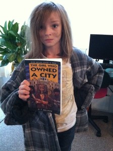 Kyla dressing up as one of her favorite book characters, Lisa, from a novel about a post-apocalyptic future in which all the adults are dead.