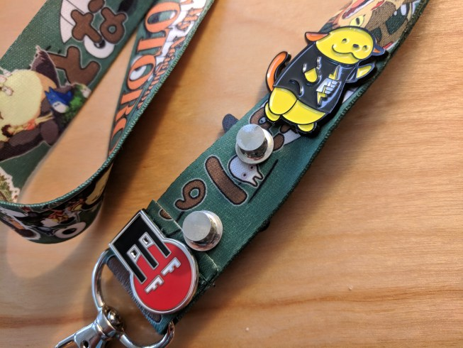 Locking pin backs and my favorite EFF and Pantheon pins on my Totoro lanyard