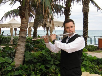David Turner poses outside next to the hotel's infinity pool with his flute, following a Florida wedding.