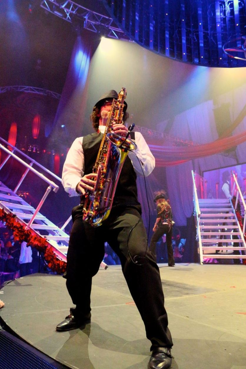 David Turner playing tenor sax on a huge stage at the Hard Rock in Hollywood, FL.