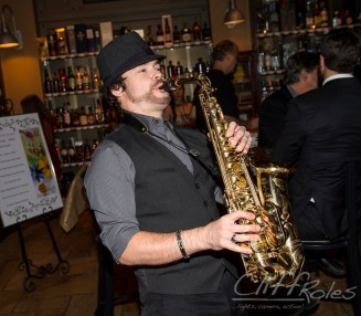 David Turner plays alto saxophone at a wine cellar