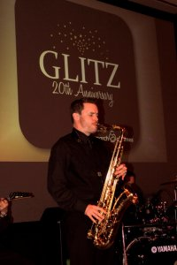 David Turner playing sax at a glitz themed corporate event in Florida.