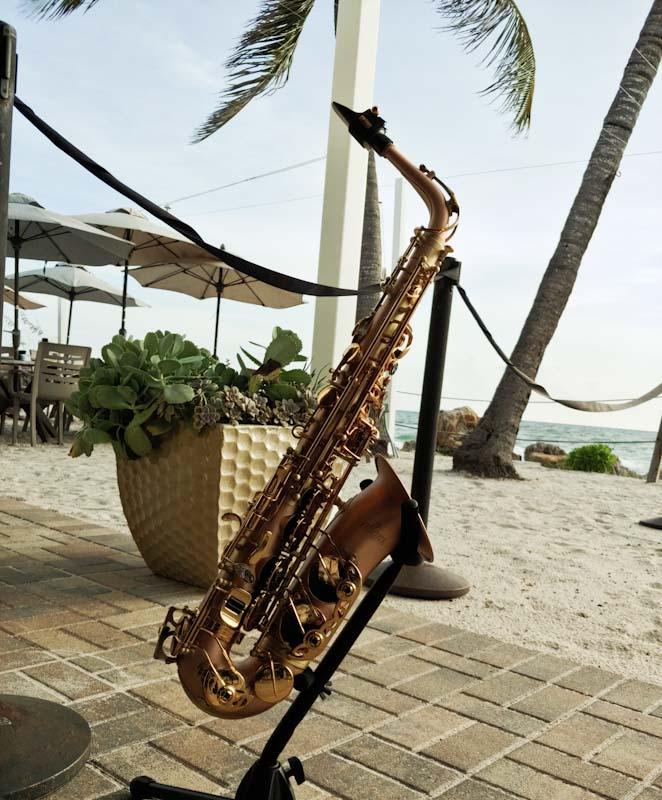 Sax Beach Wedding - A sax rests on a stand near the beach in Anna Maria Island