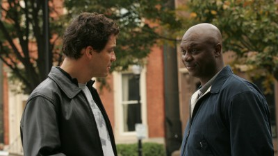 """West as McNulty, with Robert Wisdom as """"Bunny"""" Colvin."""