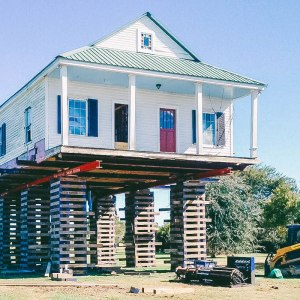 acadian home elevated raised on wood blocks leveled