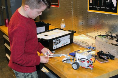 Student programming a LEGO® MINDSTORMS® robot.