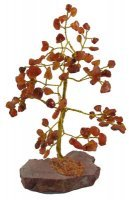 A beautiful gem tree made from carnelian chips and a crystal base Tree is made from 100 chips Height approx 18 - 20 cms