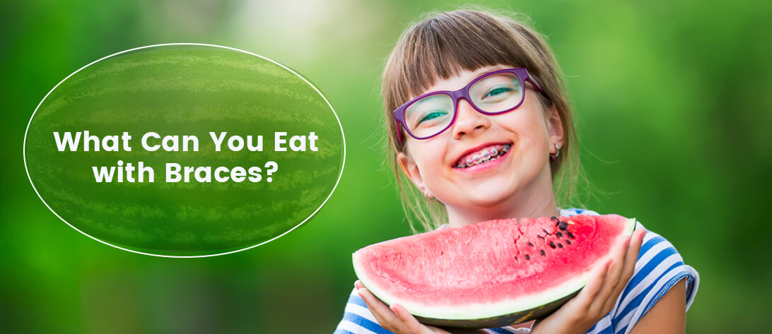 Child eating watermelon with braces