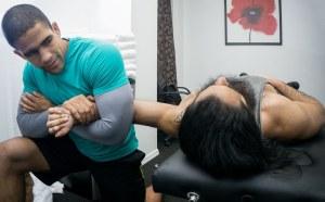 Javier Garza performing shoulder stretch