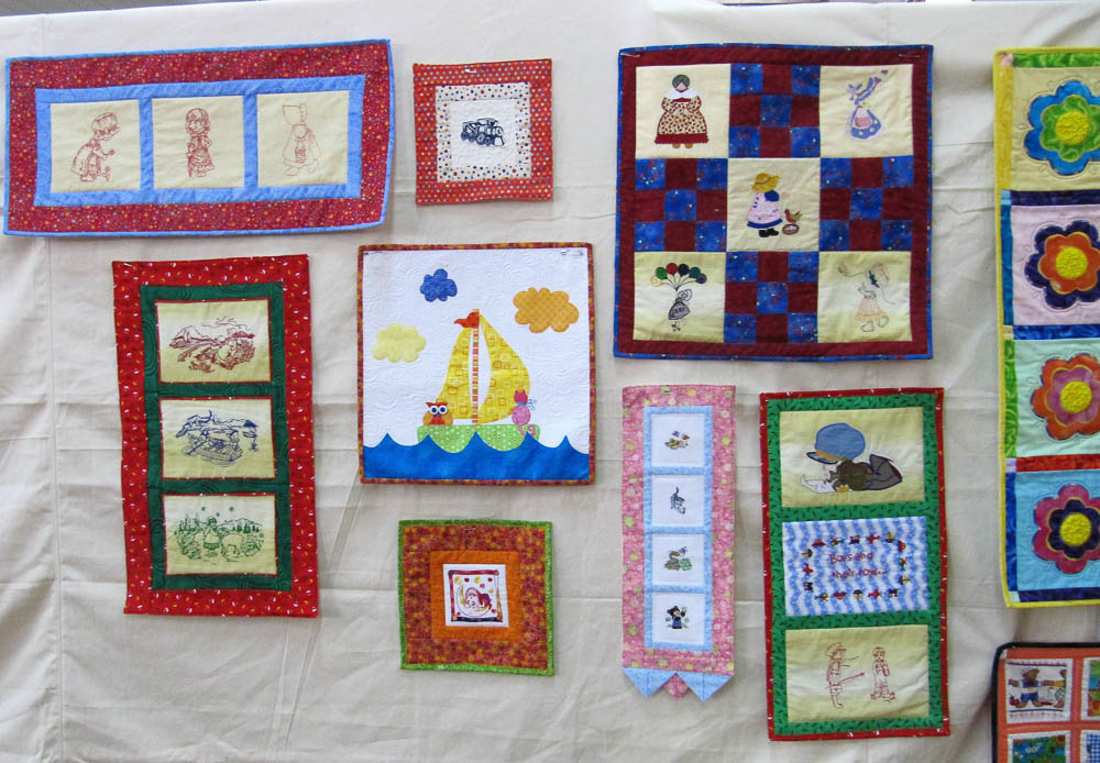 Quilted Wall hangings at Quilt Show  to donate to Children's Hospital