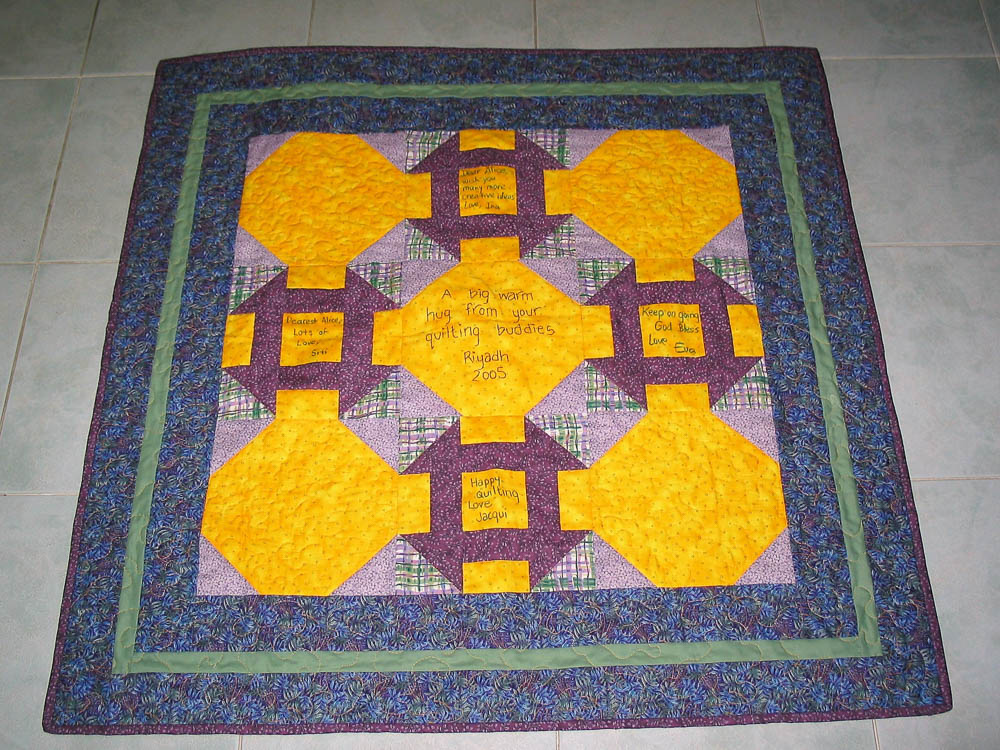 Purple and yellow snowball and churndash quilt