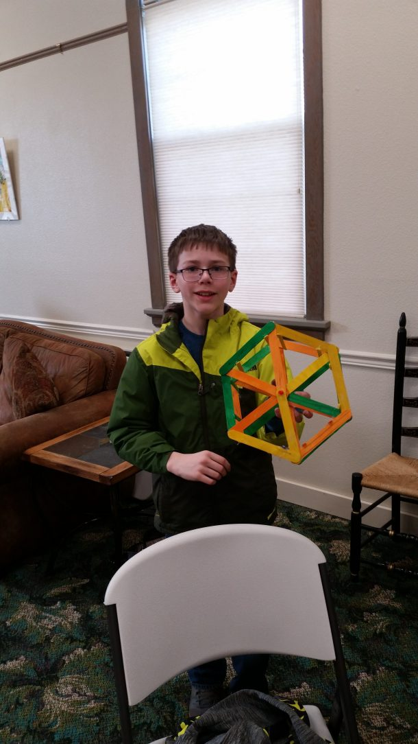 Jacob Sabin Poses with his nearly-complete ferris wheel