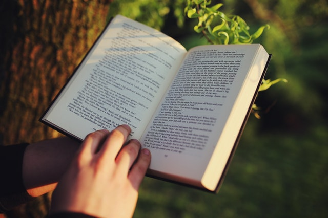 photo of hands holding a book open