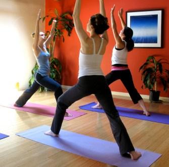 photo of 3 women practicing yoga