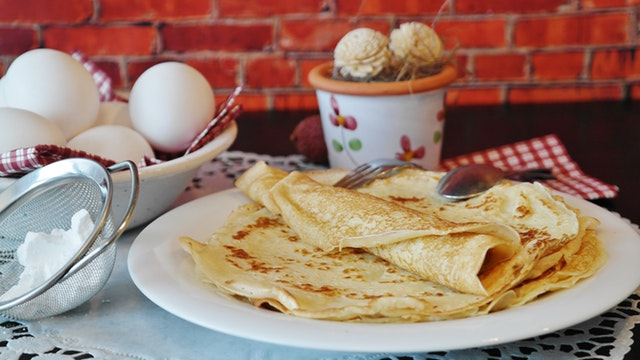 crêpes on a plate with baking supplies