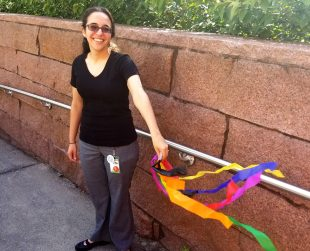Employee holding DIY rainbow streamer