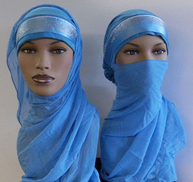 Women at plant violate code and shed traditional hijab