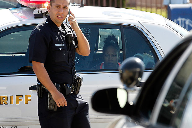Photo: A female suspect peers out from the back of a Los Angeles County sheriff deputy's patrol car after a dangerous, high-speed pursuit that started in Chino, crossed three county lines and ended on the streets of South Los Angeles on Tuesday afternoon. Credit: Luis Sinco / Los Angeles Times