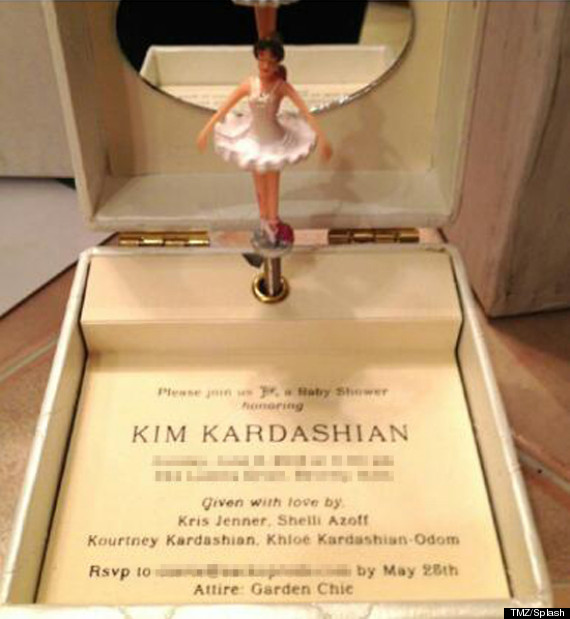 **Here is the Kim Kardashian and Kanye West baby shower invitation. It's a music-box baby shower invitation. The image obtained by TMZ.com shows the invite to Kim K's June 2nd bash. It was sent to a guest close to Kanye West and arrived as a fully functional music box, complete with a spinning ballerina dancing to a lullaby version of Kanye's song 'Hey Mama'.