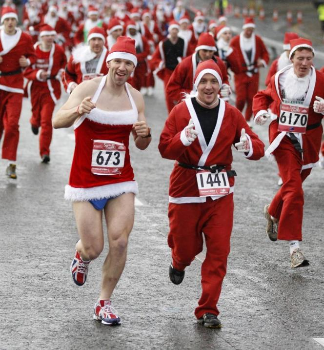 Competitors dressed as Santa Claus take part in the annual five-kilometer Santa Dash in Liverpool, northern England, Dec. 4, 2011. REUTERS/Phil Noble