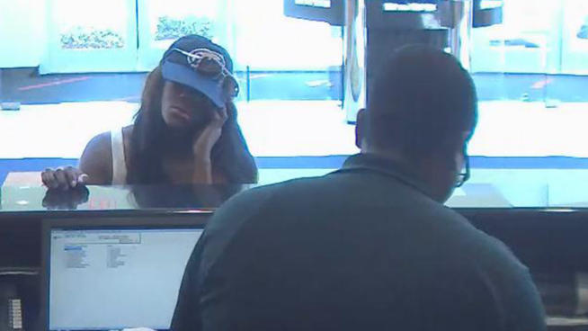 Authorities are searching for a woman who robbed a South Florida bank while pretending to chat on her cell phone.