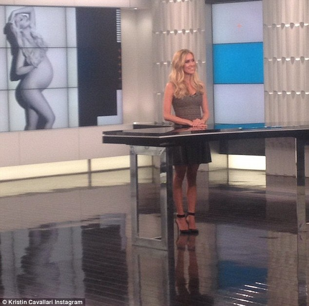 Back to work: The beauty posted a photo standing at the E! News podium with the message, 'Co-hosting @ENews today :) dress is @azzedinealaia & shoes are kristin Cavallari by @chineselaundry'